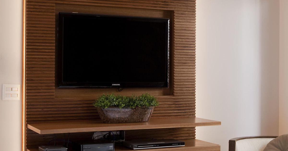Quarto de casal com painel para Televisão de Marcelo Rosset