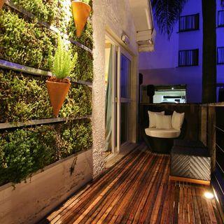 ?rea externa com jardim vertical de Greice Alburque ...